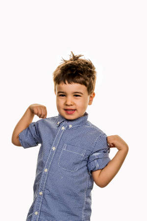 self assured: little boy in pose, a symbol of self-esteem, childhood, lightheartedness, cleverness Stock Photo