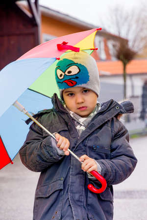 time deficit: child with umbrella, symbol of childhood, solidarity, help, aid package, bailout, Stock Photo
