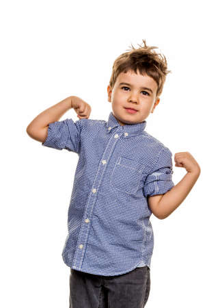 rascal: little boy in pose, a symbol of self-esteem, childhood, lightheartedness Stock Photo