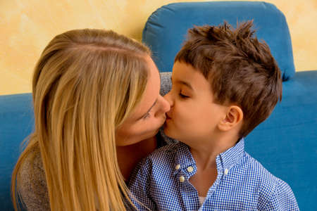 beloved: a little boy with a woman being kissed
