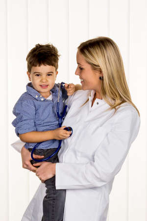 intercept: physicians and little boy icon diseases, diagnostics, heart defects Stock Photo