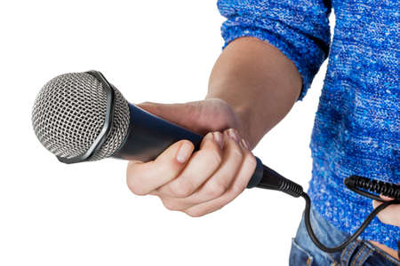 micro recording: a woman is holding a microphone in his hand. interview and poll Stock Photo
