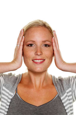 a young woman holds her ears.  Stock Photo