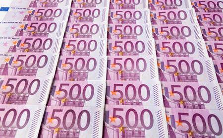 adjacent: many of five hundred euro banknotes are adjacent.