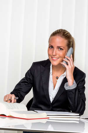 dimissal: businesswoman sitting in an office.