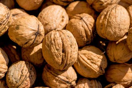 hardness: many walnuts close-up, solve problems icon, abundance, hardness Stock Photo