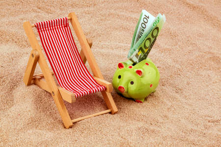 fare: beach chair with euro currency on the sandy beach.
