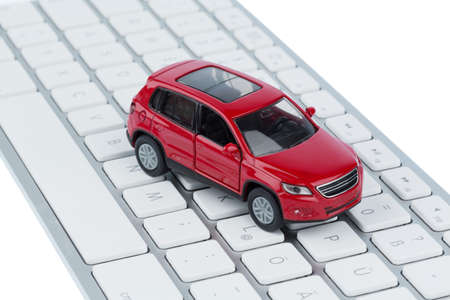 internet online: car on keyboard symbol photo for car buying and car trade on the internet Stock Photo