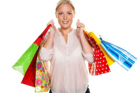 pleased: a young woman with colorful shopping bags while shopping. pleased with the deal.