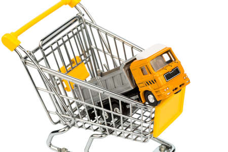 behave: a shopping cart and a truck. Stock Photo