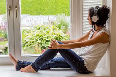 unwind: woman listening music with headphones. relax and unwind Stock Photo