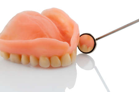 surgery expenses: teeth and mouth mirror, symbolic photo for dentures, diagnostics and payment Stock Photo