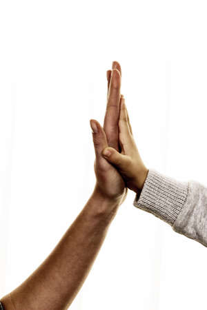 encourage: high five gesture, symbol for success, security, closeness, trust Stock Photo