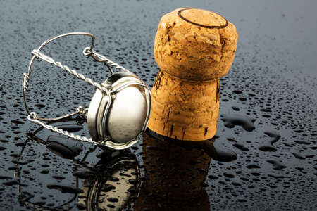 solemnity: champagne corks and clasp, symbolic photo for celebration, enjoyment and alcohol consumption