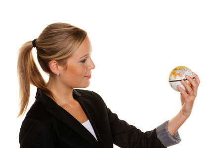 long haul journey: a young woman holding a globe in his hand. symbolic photo for travel and tourism environment