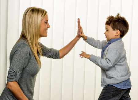 cohesion: mother and son symbol of love, fun, childhood, happiness