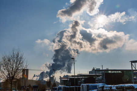 pollutants: chimney of an industrial company with smoke. symbolic photo for environmental protection and ozone.