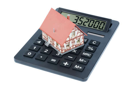 financial burden: residential building on a calculator, photo icon for house purchase, costs and savings