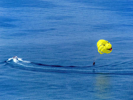 at ease: paragliding at sea, symbolic photo for adventure, leisure, fun Stock Photo