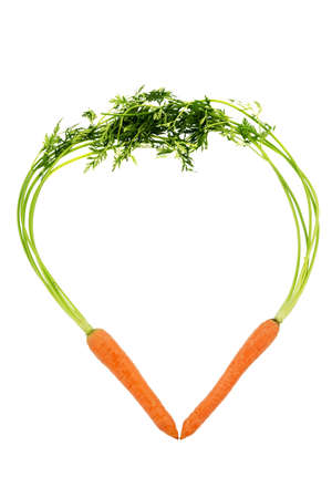 a heart made of organically grown carrots. fresh fruit and vegetables is always healthy. symbolic photo for healthy eating.