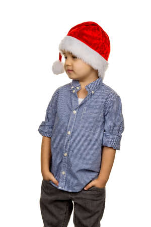 casualness: little boy with santa hat, a symbol of childhood, christmas, permeability