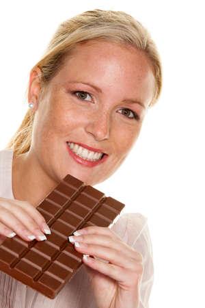 enjoyable: a young woman eating a chocolate bar enjoyable.