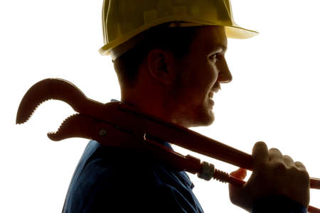 a worker in an industrial enterprise (craftsmen) with tools in hand Stock Photo
