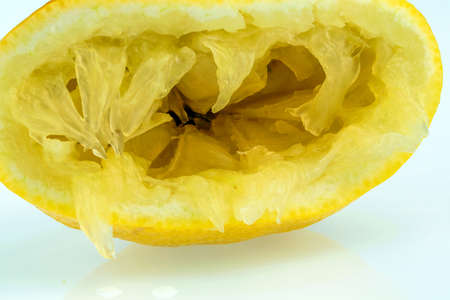 duties: one of squeezed lemon on a white background. symbolic photo for taxes, duties,