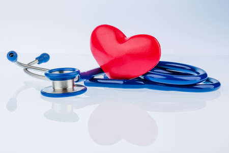 physican: a heart and a stethoscope are adjacent. symbolic photo for heart disease and heartache.