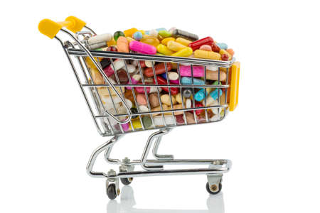 therapie: tablets with shopping cart. photo icon for the purchase of drugs on the internet