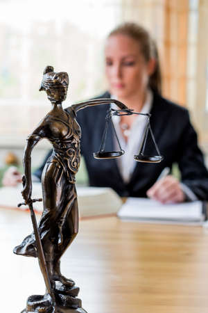 criminal law: businesswoman sitting in an office. photo icon for managers, independence or lawyer. Stock Photo