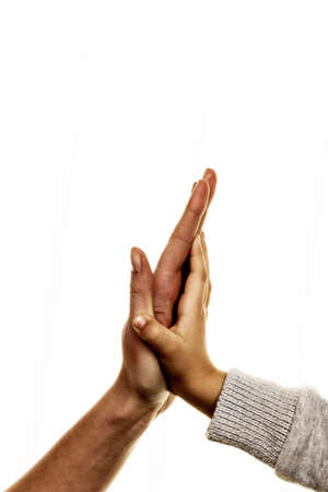 closeness: high five gesture, symbol for success, security, closeness, trust Stock Photo