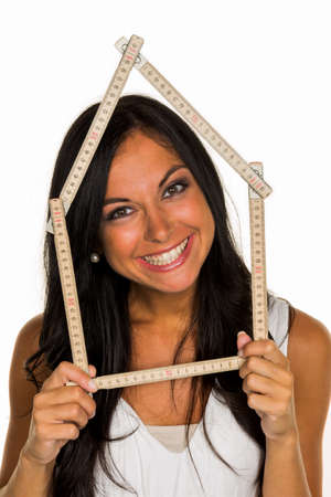 familiy: a young woman wants to build a house Stock Photo