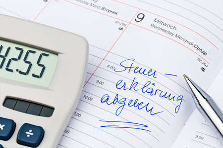 auditors: an appointment is entered on a calendar tax return Stock Photo