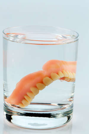nursing class: denture m water glass, symbolic photo for dentures and care