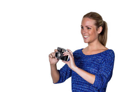 joie: a young woman with an old camera. cameras in the retro look in again.