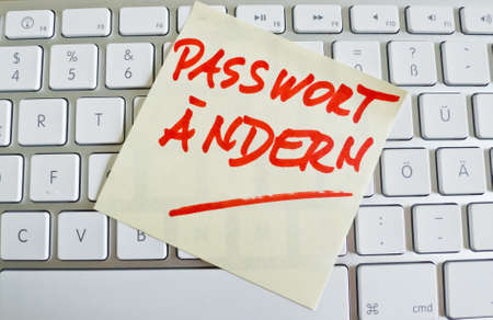 notieren: a memo is on the keyboard of a computer as a reminder  change password Stock Photo