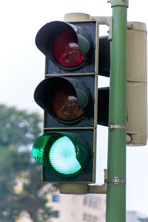 new rules: a traffic light with green light. symbolic photo for free travel, and economic success Stock Photo