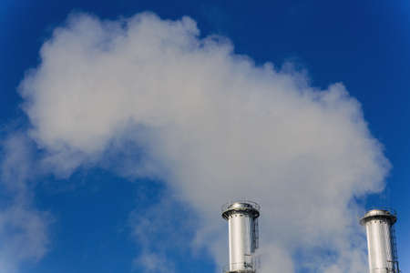 pollutants: chimney of an industrial company mikt smoke. symbolic photo for environmental protection and ozone. Stock Photo