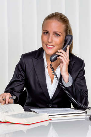 freelancers: businesswoman sitting in an office. photo icon for managers, independence or lawyer. Stock Photo
