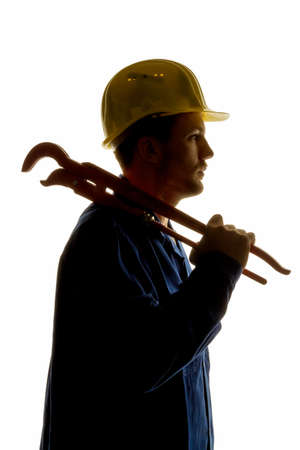 socially: a worker in an industrial enterprise with tools in hand Stock Photo