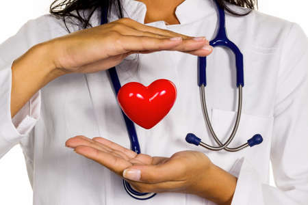pracitioner: a young doctor  symbolically holding a heart in his hand. Stock Photo