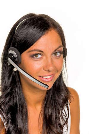 een jonge vrouw in een klant belde de klant met een headset Stockfoto