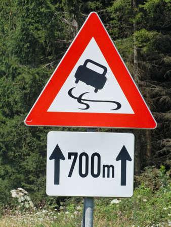 fling: warning skidding on slippery road Stock Photo