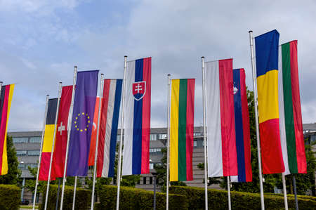 diplomacy: european flag and other flags, symbols for diplomacy and international cooperation