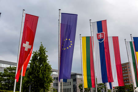 european integration: european flag and other flags, symbols for diplomacy and international cooperation