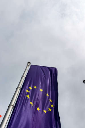 waistband: european flag and other flags, symbols for diplomacy and international cooperation