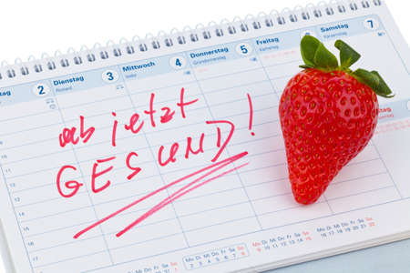 healthier: strawberry and calendar. good resolution for healthy diet Stock Photo