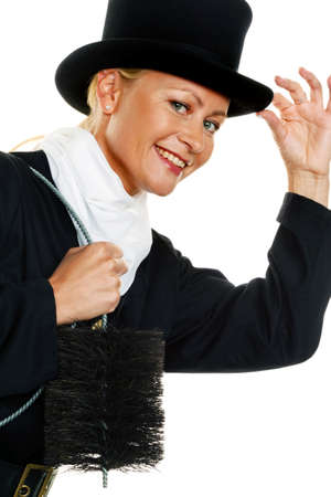 swept: woman as a chimney sweep. lucky charms new years eve and new year. Stock Photo