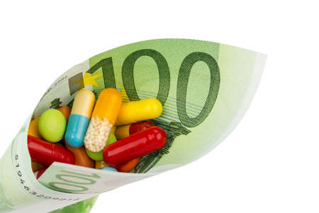 pracitioner: tablets and one hundred euro banknote symbol photo: charges for medicine and drugs the pharmaceutical industry